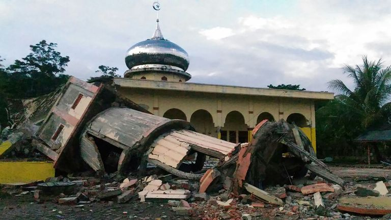A collapsed mosque minaret after an earthquake struck Indonesia's Aceh province