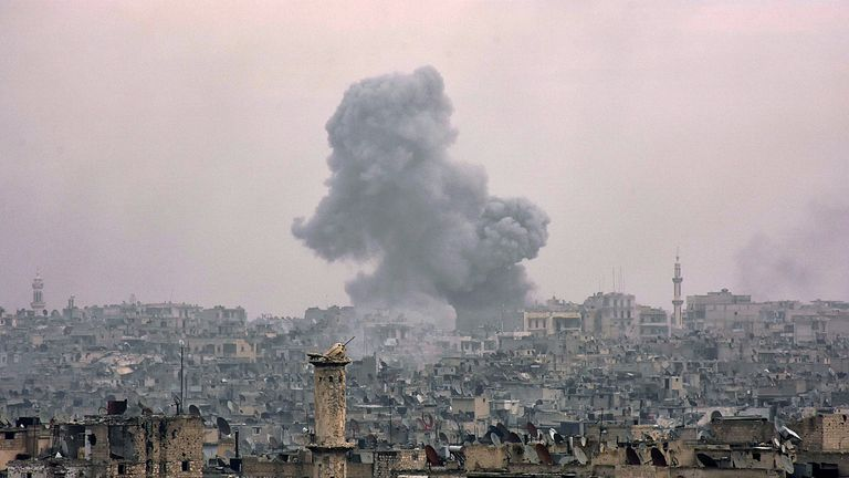 Destroyed buildings in Aleppo's eastern al Shaar neighbourhood as Syrian pro-government troops advance towards the area