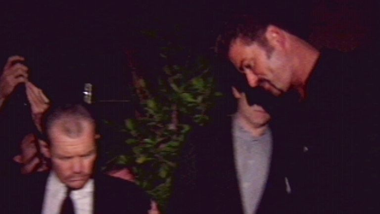 "In 1998, George Michael was arrested for ""lewd conduct"" in the public toilets of Los Angeles' Will Rogers Memorial Park. He had previously refused to comment on speculation he was gay. Here, he leaves his Beverly Hills home, appearing for the first time since the arrest"