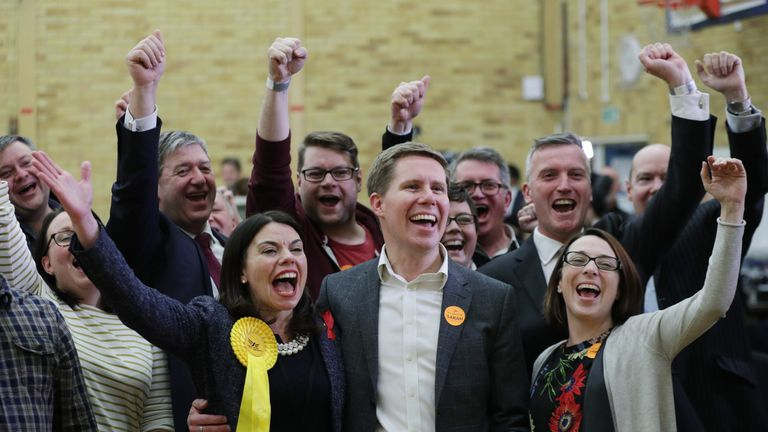 Sarah Olney with her husband Ben and Lib Dem supporters celebrate