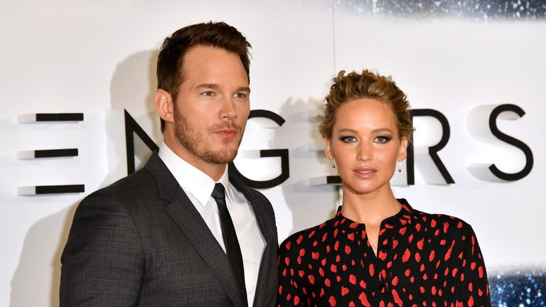 Chris Pratt and Jennifer Lawrence attend a photocall for Passengers