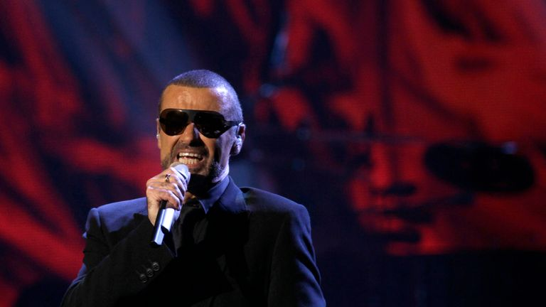 George Michael performs on stage in 2011