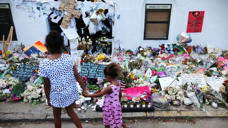 Children look on at the memorial in front of the Emanuel African Methodist Episcopal Church on June 23, 2015 in Charleston, South Carolina