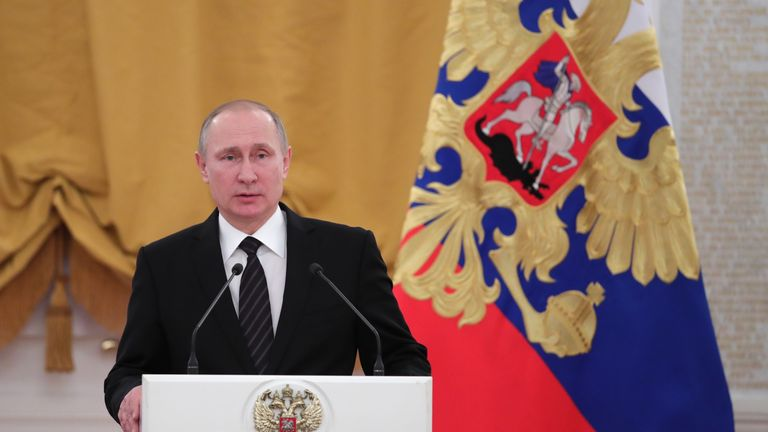 Russian President Vladimir Putin delivers a speech during a reception dedicated to the celebration of the New Year at the Kremlin in Moscow on December 28, 2016