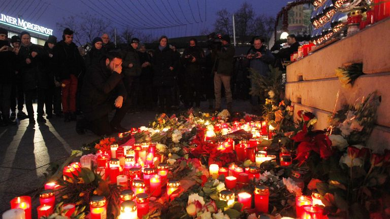 Mourners remember those who died in the attack on Berlin's Christmas market