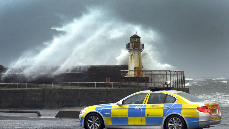 Waves crash into the harbour wall in Ardrossan in Ayrshire