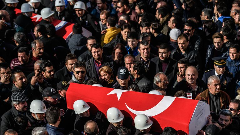 The funeral ceremony at Istanbul's police headquarters after the blasts outside the stadium