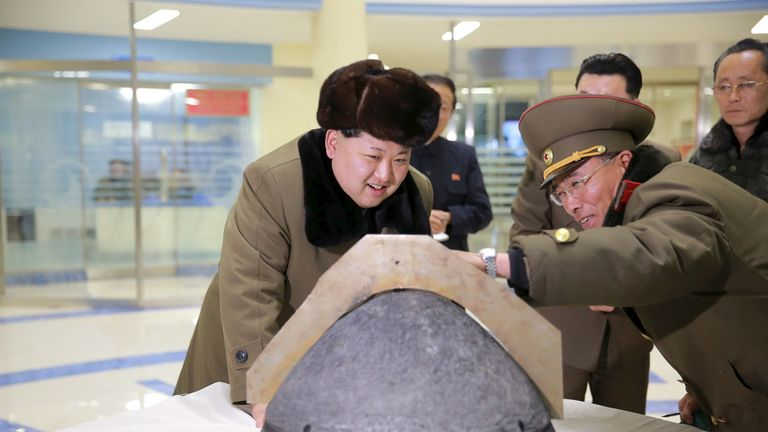 Kim Jong-Un inspects the tip of a warhead after a simulated test earlier this year