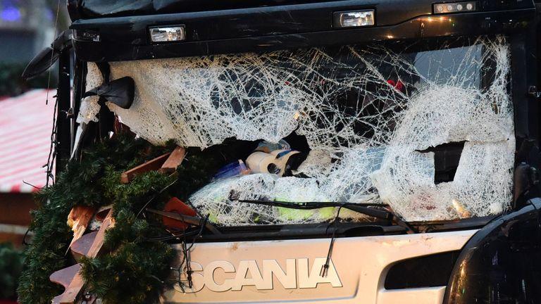 The broken windshield of the lorry that crashed into a Christmas market in Berlin