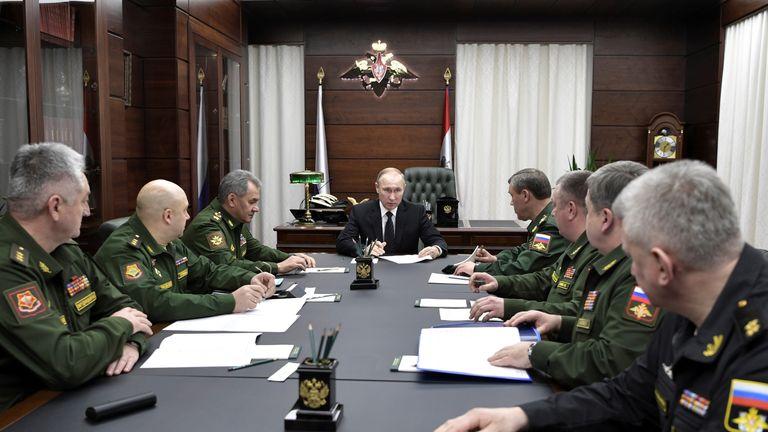 Vladimir Putin meets his military chiefs