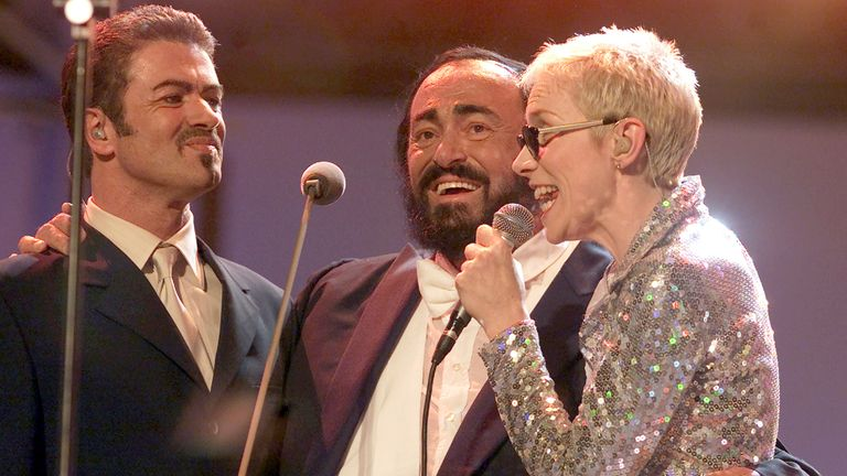 George Michael performs with Luciano Pavarotti and Annie Lennox in 2000