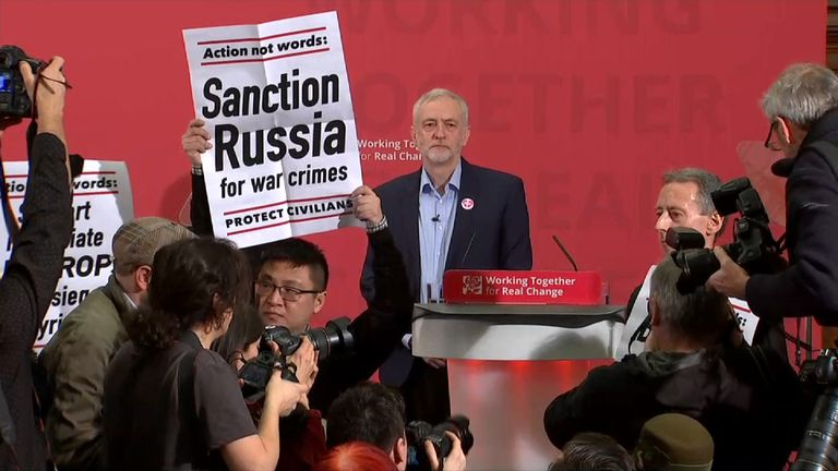 Jeremy Corbyn's speech is interrupted by a protest over Syria