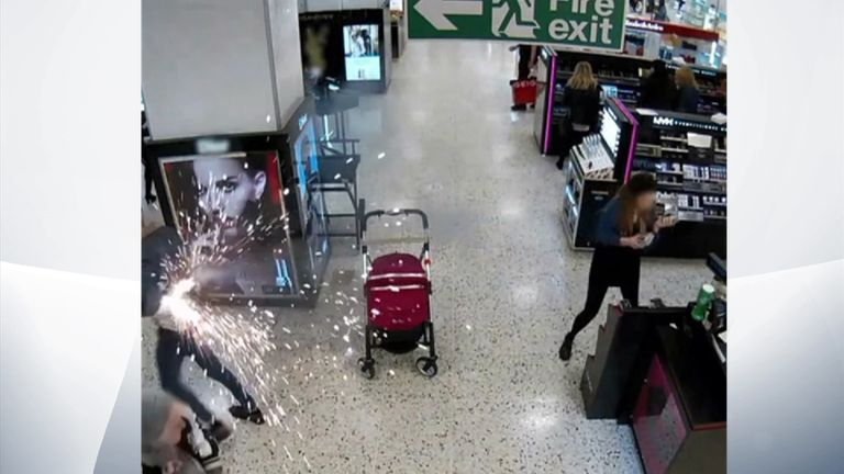 The man rushes away from the pram as the battery explodes