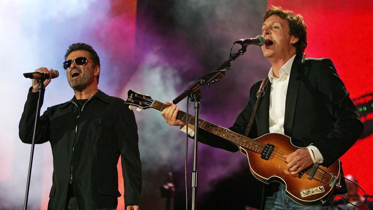 George Michael performs with Paul McCartney in Hyde Park in London in 2005
