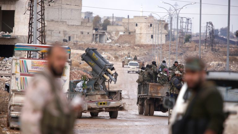 Syrian government troops in the al Haidariya neighbourhood of Aleppo