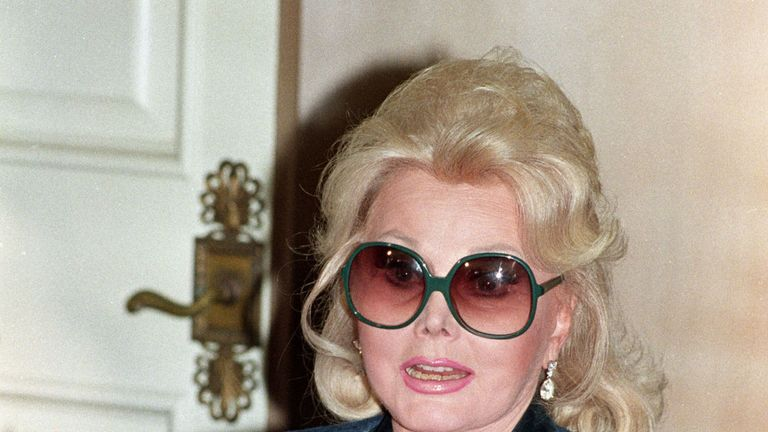 The socialite reads a statement at her Beverly Hills home in 1992 following a federal court ruling