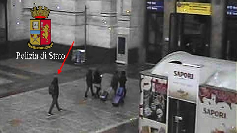 Anis Amri (L), the Tunisian suspect of the Berlin Christmas market attack, is seen in this photo taken from security cameras at the Milan Central Train Station in downtown Milan, Italy December 23, 2016, hours before he was shot dead after pulling a gun on police during a routine check.