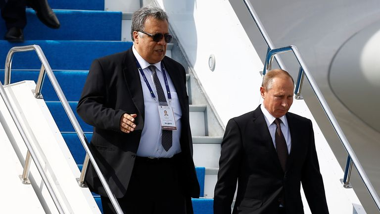 Russian Ambassador to Turkey Andrei Karlov (L) accompanies Russian President Vladimir Putin who disembarks from the Presidential aircraft at Ataturk airport in Istanbul, Turkey, October 10, 2016