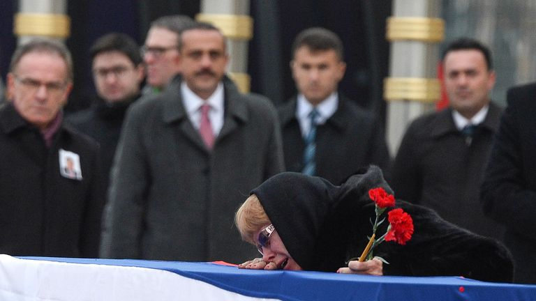 Marina Karlov mourns her husband laying her head on top a flag-wrapped coffin of late Russian Ambassador to Turkey Andrei Karlov before being carried to a plane by Turkish soldiers during a ceremony at Esenboga airport on December 20, 2016 in Ankara. Turkey. Russia's ambassador to Turkey, Andrey Karlov, was shot dead by a Turkish policeman shouting 'Don't forget Aleppo! Don't forget Syria' at an art exhibition in the Turkish capital of Ankara
