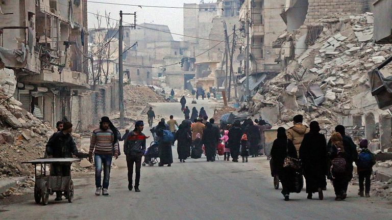 Syrian civilians flee the Sukkari neighbourhood of Aleppo