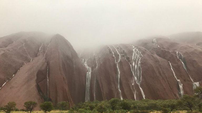 Stunning waterfalls on Uluru. Pic: Parks Australia