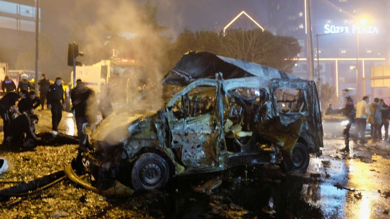 A damaged vehicle is seen after a blast outside a football stadium in Istanbul