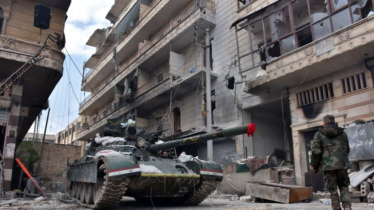 Syrian pro-government forces manoeuver a tank
