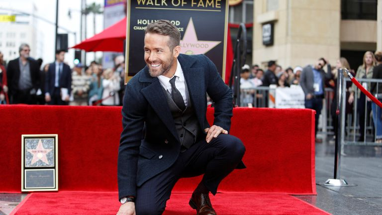 Actor Ryan Reynolds touches his star on the Hollywood Walk of Fame