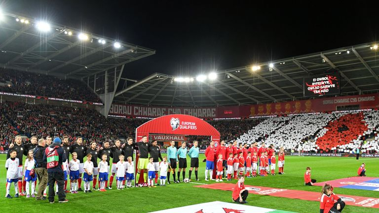 Fans make a poppy mosaic before Wales' match against Serbia in Cardiff