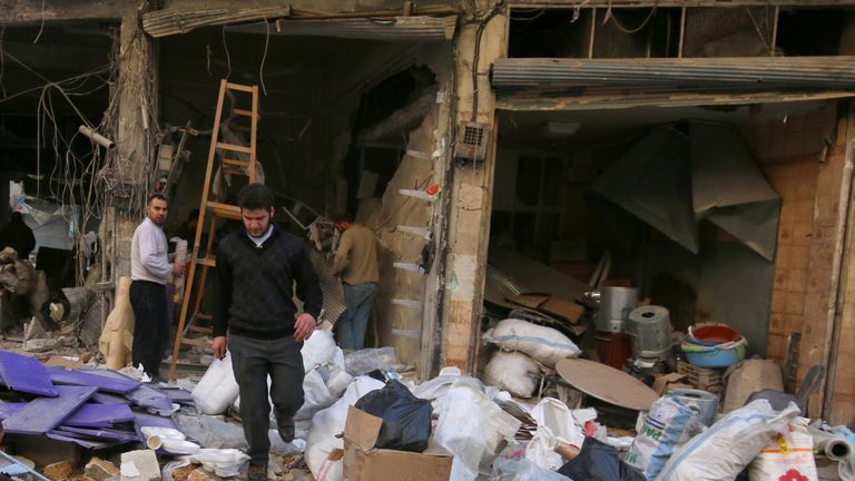 Men salvage belongings from their damaged shops at a site hit yesterday by airstrikes in the rebel held al-Shaar neighbourhood of Aleppo, Syria November 17, 2016. REUTERS/Abdalrhman Ismail