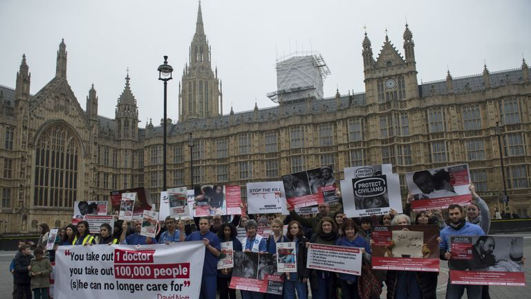 Doctors and nurses from public health charity Medact, before holding a 'die-in', outside the Houses of Parliament, London, in response to the ongoing impact of the Syrian conflict on civilians and health workers