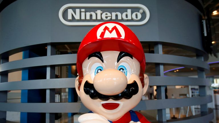 "A figure depicting ""Mario"", a character in Nintendo's ""Mario Bros."" video games, is displayed at the company showroom in Tokyo, Japan July 14, 2016"