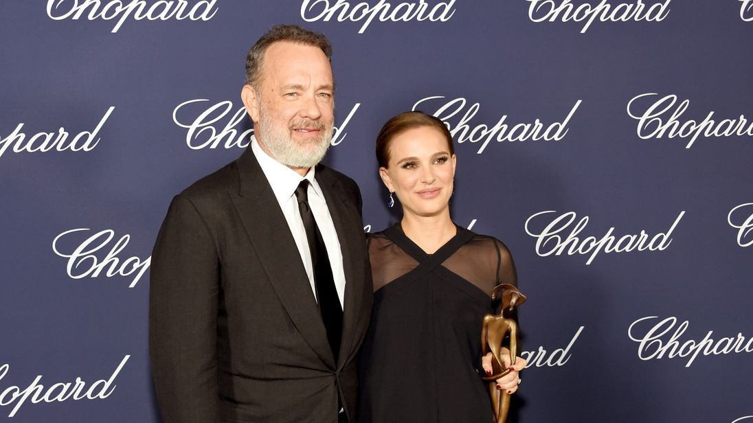 Actress Natalie Portman poses with Tom Hanks during the annual Palm Springs International Film Festival awards.