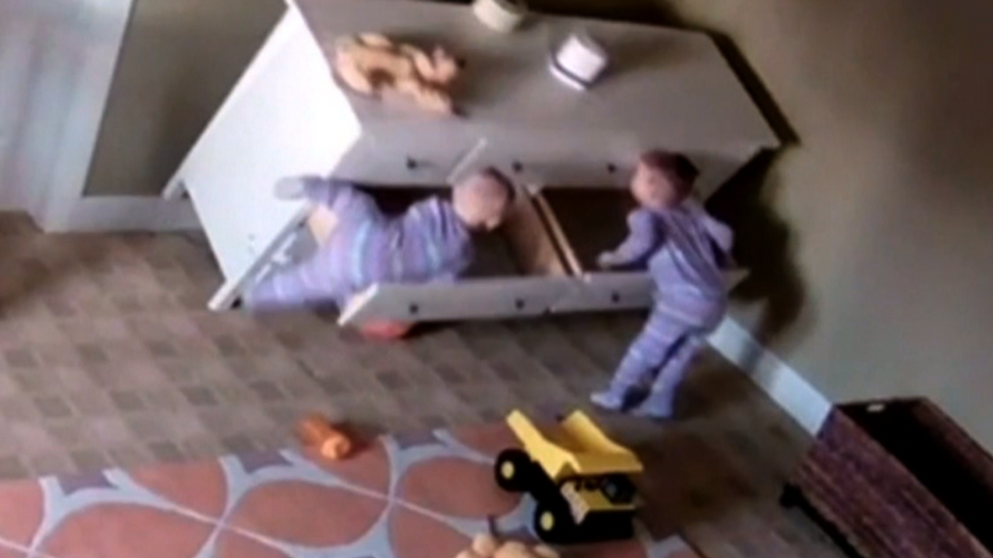 Two-year-old Bowdy sprang into action when his twin brother became trapped by a fallen dresser.