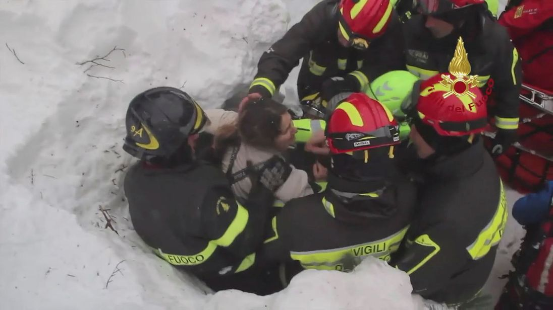 A survivor is pulled from the hotel