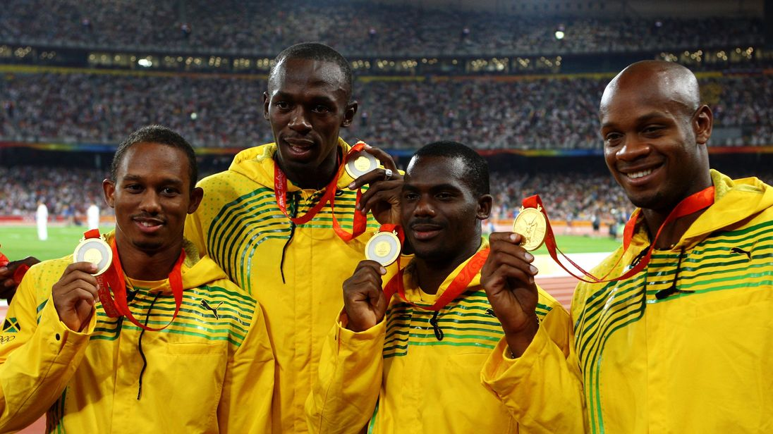 Michael Frater (l), Usain Bolt, Nesta Carter and Asafa Powell (r) receive their relay gold medals at Beijing