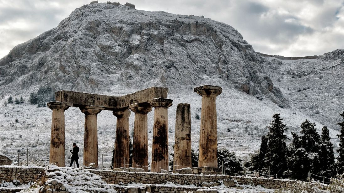 Snow covers the Temple of Apollo in Corinth, Greece.