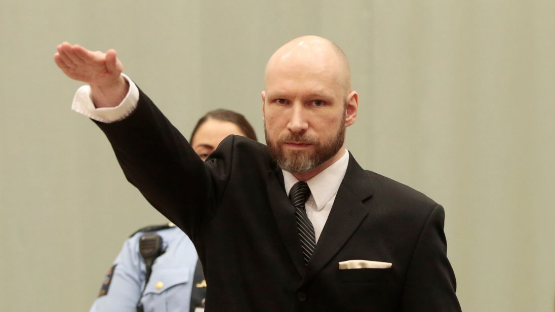 Anders Behring Breivik makes a Nazi salute ahead of his appeal hearing at a court at the Telemark prison in Skien, Norway