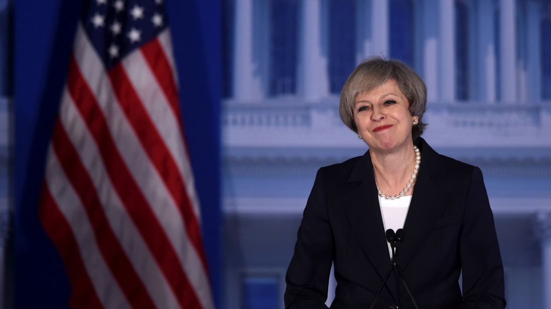 Theresa May acknowledges applause during her speech in Philadelphia