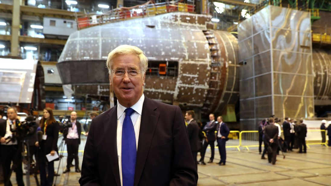 Defence Secretary Michael Fallon speaks to media in front of HMS Audacious at BAE Systems, Burrow-in-Furness, where he will attend a steel-cutting ceremony to formally commence production of the UK's next generation of nuclear submarines