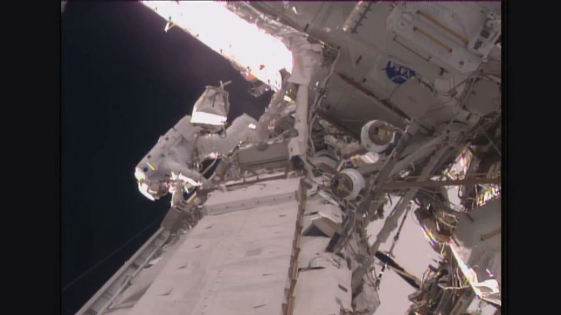 Astronauts float outside International Space Station in spacewalk. Pic: NASA