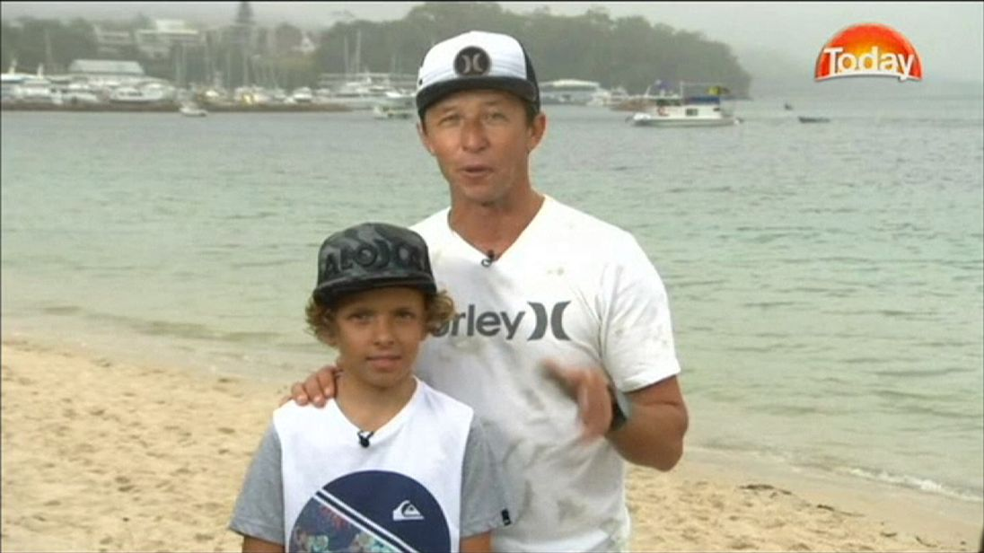 Eden Hasson with dad Chris Hasson:  The ten year old shared a wave with what experts say is probably a Great White shark.