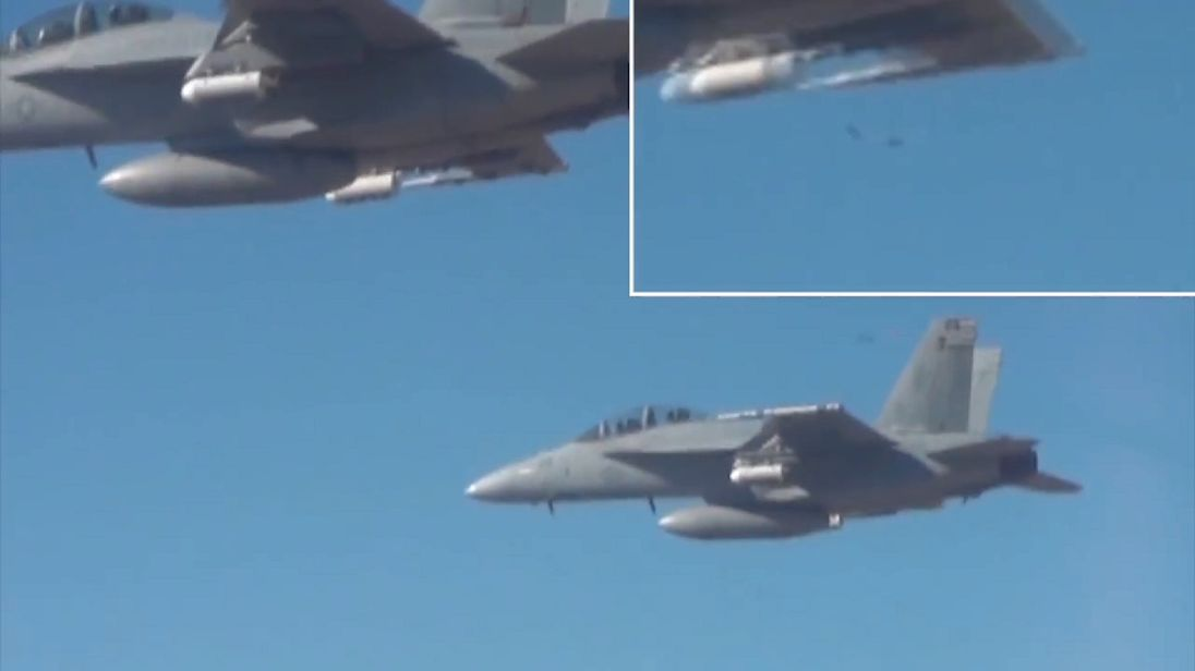 A couple of drones are released (top right). Pic: US Department of Defense