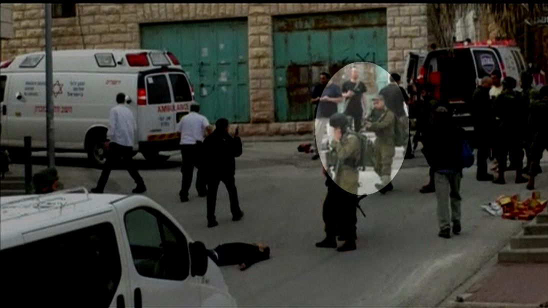 Elor Azaria (highlighted) shoots the incapacitated man in the head