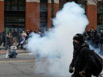 Police target demonstrators with a stun grenade