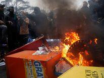 Activists set light to bins and newspaper stands