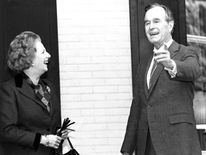 Margaret Thatcher and U.S. Vice President George Bush pause for the press on the porch of the Vice President's residence, 1986
