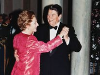 U.S. President Ronald Reagan and Britain's Prime Minister Margaret Thatcher dance in the foyer of the White House in 1988