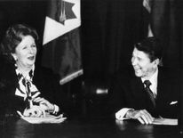 Margaret Thatcher and President Reagan share a laugh during a meeting of the Allied leaders in New York, 1985