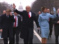 Donald Trump walks with wife Melania and son Barron during the parade